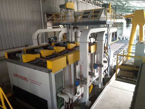 Abrasive removal system for roller conveyor shot blasting machine